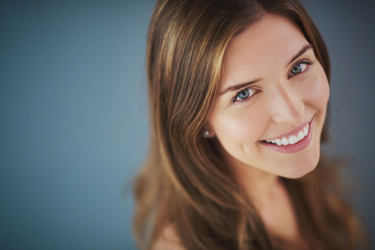 Picture of a woman with light brown hair smilling